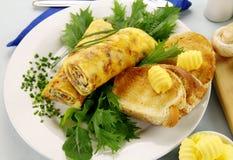 rullande omelett royaltyfri bild