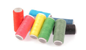 Rullar av färgtrådar Arkivbild