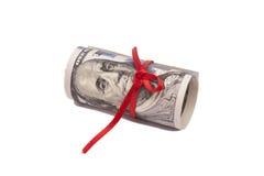 Rulle av 100 dollar och den röda pilbågen Arkivfoton