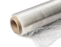 Rulle av inpackning av den plast- elasticitetsfilmen Fotografering för Bildbyråer