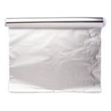 Rulle av papper för aluminium folie över isolerad vit bakgrund Arkivbild