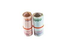 Rulle av thailändska pengar Arkivbild