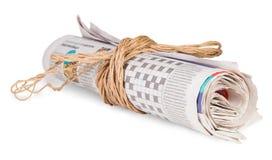 Rulle av tidningar som binds med ett rep Fotografering för Bildbyråer