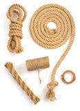 Rulle av tvinnar kabel och tråden på vit Fotografering för Bildbyråer
