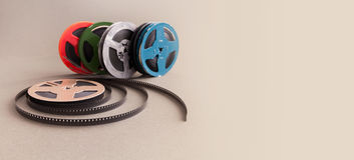 Rulle för film för bio för mm för tappningsamling 8 Färgrik celluloidtillbehör för Retro design för hemvideoprojektor grått royaltyfri bild