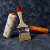 Rulle och borste för stålhjälpmedel för klämma röd liten working fotografering för bildbyråer