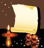 Rulle, stearinljus och julbollar Arkivbild