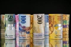 Rulli del franco svizzero fotografie stock libere da diritti