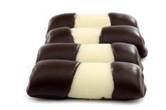 Rulli dolci del cioccolato del marzapane Immagini Stock