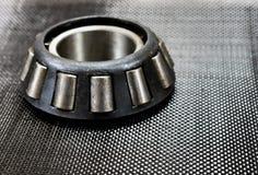 Rullo affusolato automobilistico riguardante la fibra del carbonio fotografia stock