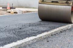 Rullo compressore all'asfalto - primo piano Fotografia Stock