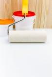 Rullo con le latte della pittura pronto per usare Fotografia Stock Libera da Diritti