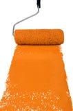 Rullo con vernice arancione fotografia stock libera da diritti