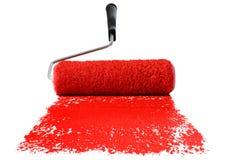 Rullo con vernice rossa fotografie stock