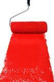 Rullo con vernice rossa fotografia stock