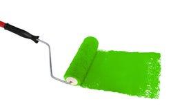 Rullo con vernice verde Fotografie Stock