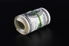 Rullo dei soldi (isolato sul nero) Fotografie Stock Libere da Diritti