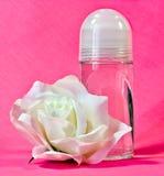 Rullo sul deodorante e su Rosa Immagine Stock Libera da Diritti