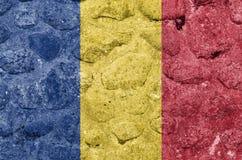 Rumänien flagga på en stenvägg stock illustrationer