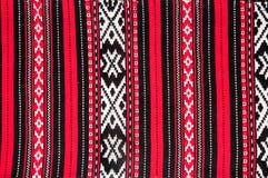 Rumänsk traditionell röd matta Arkivbild