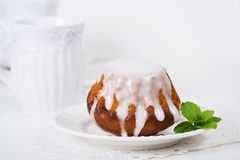 Rum baba cake on plate Stock Photography