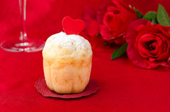 Rum Baba decorated with hearts on a red background Royalty Free Stock Images