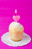Rum Baba decorated with a lighted candle in the form of heart Stock Photos