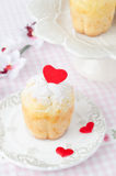 Rum Baba decorated with red hearts on a plate Royalty Free Stock Photography