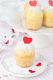 Rum Baba decorated with red hearts on a plate and a few in the b Stock Photography