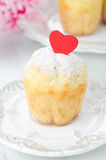 Rum Baba decorated with red hearts and topped with powdered suga Royalty Free Stock Image