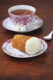 Rum baba tea Royalty Free Stock Photos