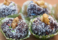 Rum balls. In coconut and walnut Royalty Free Stock Photo