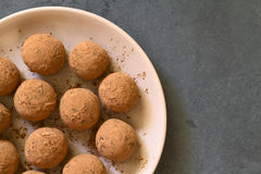 Rum Balls. Covered with cocoa powder, photographed overhead on slate with natural light (Selective Focus, Focus on the top of the balls Royalty Free Stock Photos