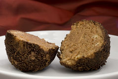 Rum chocolate truffle halves. With nice red background royalty free stock photography