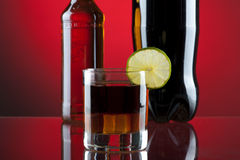 Rum-cola cocktail. On red background Royalty Free Stock Photography