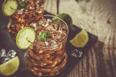Rum and cola cocktail in glasses Stock Image