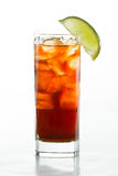 Rum and cola. Cuba libre, rum and cola cocktail served in a tall glass with a lime garnish on a black background stock photography