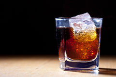 Rum and cola. In glass with ice stock photos