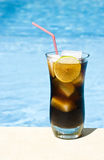 Rum and Cola by the Pool Stock Image