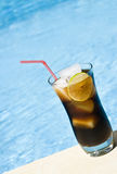 Rum and Cola by the Pool Stock Images