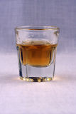 Rum in a crystal glass Royalty Free Stock Image