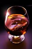 Rum. Glass of rum in dark background Stock Photos