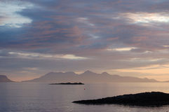 Rum late evening from Arisaig. The island of Rum late summers evening from Arisaig royalty free stock images