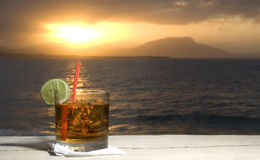 rum on rocks Cocktail by the sea Royalty Free Stock Photos