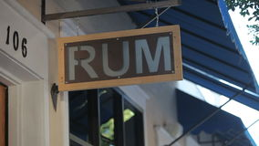 Rum Sign Under a Blue Awning that is Blowing in the Wind stock video
