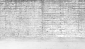 Rum som göras av betongvägg- och betongFloorAbstract den vita inre av tomt rum med betongväggar Arkivbild