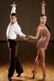 Rumba dance. Dance couple in brown dress dancing rumba Stock Images