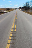 Rumble strips engraved into a secondary highway Royalty Free Stock Photography