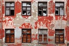 Сrumbling facade with broken windows. Royalty Free Stock Photography