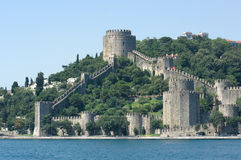 Rumeli Fortress. Towers and crenellated walls of Rumeli's fortress on the Bosporus waterfront, Istanbul Stock Images